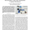 A Rapidly Prototyped 2-axis Positioning Stage for Microassembly using Large Displacement Compliant Mechanisms