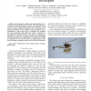 Detection and Tracking of External Features in an Urban Environment Using an Autonomous Helicopter